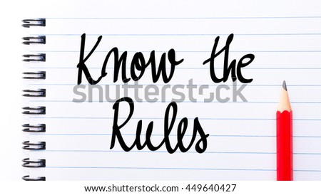 Know The Rules written on notebook page with red pencil on the right