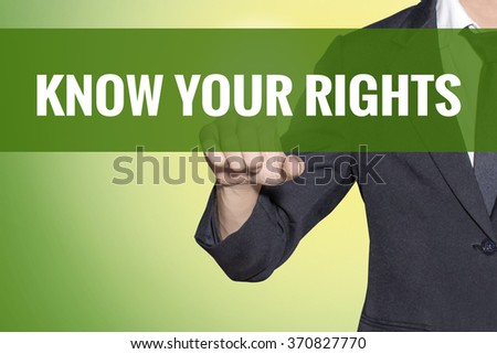 Know Your Rights word Business man touch on vintage yellow green tab virtual screen - stock photo