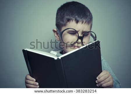 knowledge, dark-haired young student reading a funny book, reading and learning