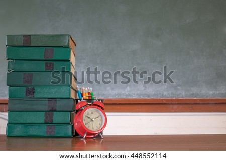 knowledge font in clock and books at library - stock photo