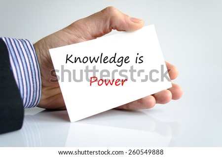 Knowledge is power note in bussines man hand - stock photo
