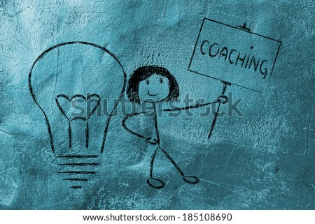 knowledgeable girl holding a sign saying Coaching - stock photo