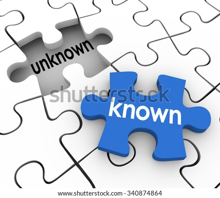 Known word on a puzzle piece about to fill in a hole marked Unknown to illustrate finding missing information to complete knowledge or learning - stock photo