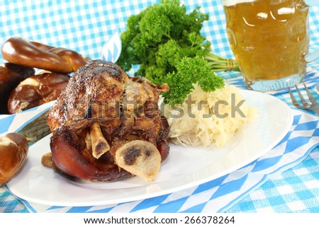 knuckle of pork with pretzels and beer - stock photo