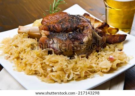 knuckle of pork with sauerkraut - stock photo