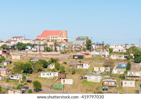 KNYSNA, SOUTH AFRICA - MARCH 5, 2016: A view of Queen of the Holy Rosary Catholic Church and houses and shacks in Khayalethu Township in Knysna