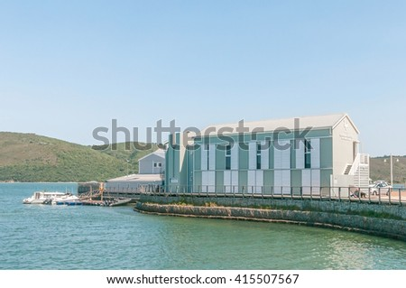 KNYSNA, SOUTH AFRICA - MARCH 3, 2016: The Regional Office of the South African National Parks Board is situated at the historic Thesens Island Jetty