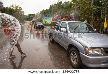 KO CHANG, THAILAND - APR 13: People celebrate Songkran Festival, on 13 Apr 2013 on Ko Chang, Thailand. Songkran is celebrated in Thailand as the traditional New Year's Day from 13 to 16 April.