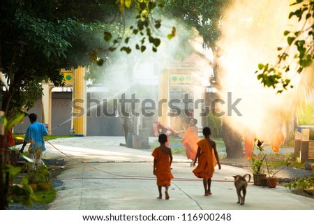 KO CHANG, THAILAND - OCT 23: Unidentified children spend a monk at Buddhist monastery Wat Klong Prao, Oct 23, 2012 on Chang, Thailand. At 32,000 monasteries  Thailand is home to about 200,000 monks.