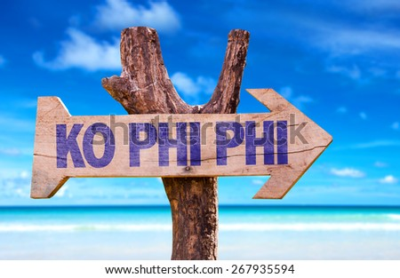 Ko Phi Phi wooden sign with beach background - stock photo