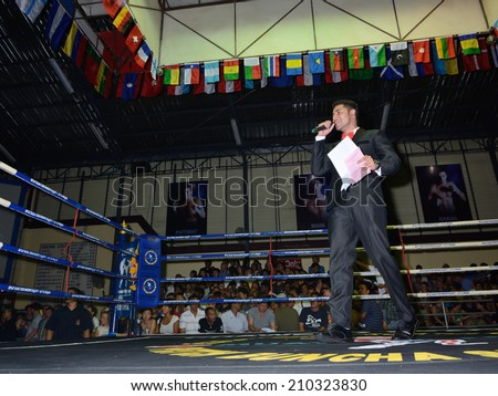 KO SAMUI,SURAT THANI - AUGUST 9 : Unidentified master of ceremonies at the third anniversary boxing match at Phetchbuncha Thai boxing stadium  on August 9, 2014 in ko samui, Surat Thani, Thailand. - stock photo