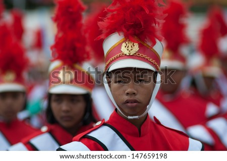 KO SAMUI,SURAT THANI - JULY 17 : Unidentified Thai students 13 - 16 years old in ceremony uniform during sport parade on July 17, 2013 in ko samui, Surat Thani, Thailand.