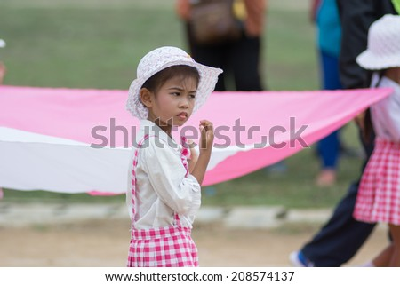 KO SAMUI,SURAT THANI - JULY 22 : Unidentified Thai students 4 - 8 years old in ceremony uniform during sport parade on July 22, 2014 in ko samui, Surat Thani, Thailand.