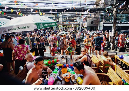KO SAMUI, THAILAND - APRIL 13: Crowd of unidentified people at the celebration of Songkran Festival (Thai New Year) on April 13, 2014 in Chaweng Main Road, Ko Samui island, Thailand.