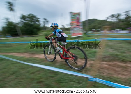 KO SAMUI, THAILAND - SEPTEMBER 7: Unidentified biker in action at the Samui MTB XC 2014 on September 7,2014 in Ko Samui island, Thailand. The forth of mountain bike race in ko samui thailand.