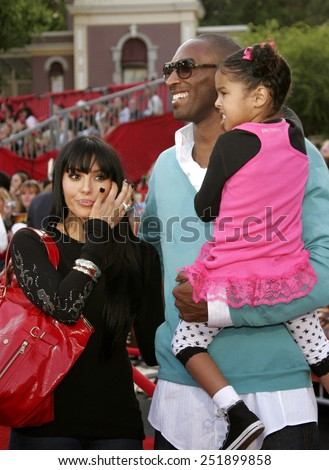 "Kobe Bryant with wife Vanessa and daughter Natalia attend the World Premiere of ""Pirates of the Caribbean: At World's End"" held at Disneyland in Anaheim, California on May 19, 2007.  - stock photo"