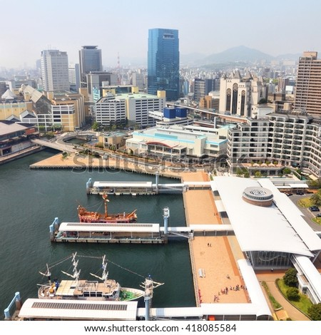 Kobe, Japan - city in the region of Kansai in Hyogo prefecture. Aerial view with skyscrapers and sea embankment.