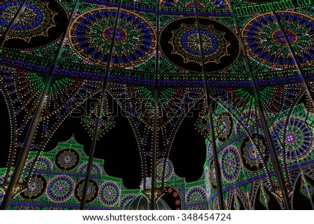 KOBE, JAPAN - DECEMBER 6, 2015: Kobe Luminarie is held annually to commemorate the victims of the Great Hanshin-Awaji Earthquake. Luminarie draws three to five million people each year since 1995. - stock photo