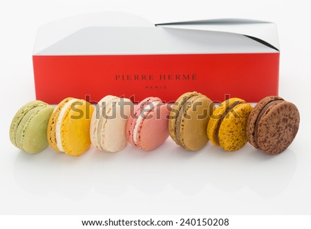 "KOBE, JAPAN - DECEMBER 27, 2014: Macaroons from a Pierre Herme Paris branded pastry boutique. French Vogue magazine dubbed renowned French pastry chef Pierre Herme as ""The Picasso of Pastry."" - stock photo"