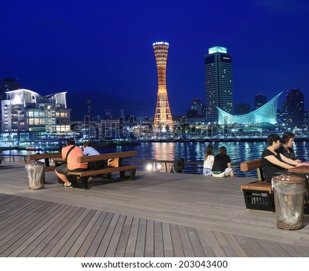 KOBE JAPAN - 2 JUNE, 2014: Unidentified people relax at MOSAIC viewing deck in Haborland.Harborland is a shopping district which was made on the site of former freight yard.  - stock photo