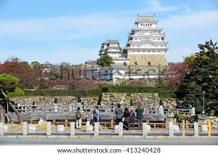 KOBE, JAPAN - Nov 5: Unidentified tourists to visit Himeji Castle in autumn season on November 5, 2015 in Kobe, Japan. it is a also called white heron castle and UNESCO world heritage site - stock photo