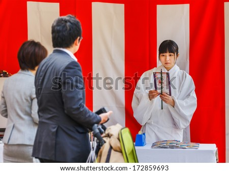 "KOBE, JAPAN - NOVEMBER 17: Miko at Ikuta-jinja in Kobe, Japan on November 17, 2013. ""Miko"" is an institutionalized in daily shrine life, trained to do sacred cleansing to perform a sacred dance"