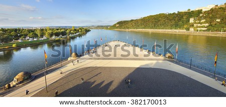 "KOBLENZ, GERMANY-SEPTEMBER 28, 2012: Confluence of Rhine and Mosel rivers. Deutsches Eck ""German Corner"" is the name of a headland where the Moselle joins the Rhine;"