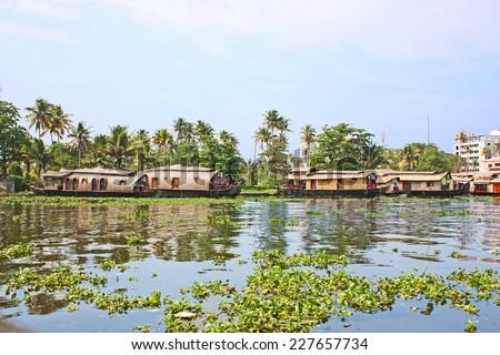 KOCHI - DECEMBER 5: Houseboat , sightseeing boat at famous backwaters of Kerala around Kochi on December 5, 2012 in Kochi, Kerala, India.  - stock photo