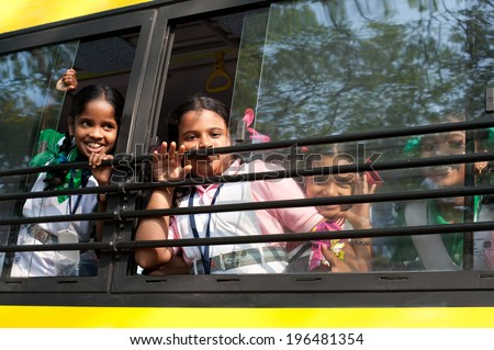 KOCHI, INDIA - FEBRUARY 25: Unidentified school children in uniform going home after classes at primary school by school bus on February 25, 2013. India, Cochin (Kochi),  Kerala - stock photo