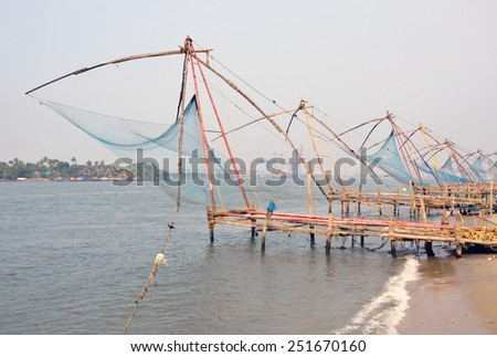 KOCHI, INDIA - JANUARY 31, 2015: Chinese fishing nets have been used for the last 500 years and become a popular tourist attraction. These were introduced by Portuguese settlers from Macau. - stock photo