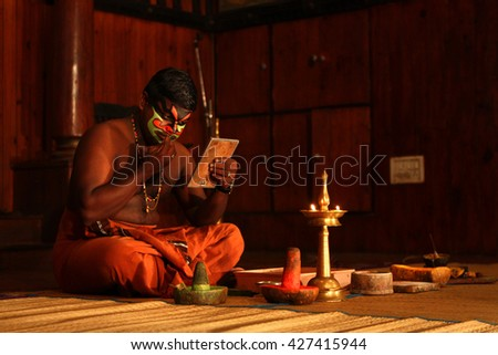 KOCHI,INDIA-MAY 13: Kathakali dancer put makeup before the dance performance at Kochi,India on May 13,2016. Kathakali is a folk dance form of Southern India where dancers prepare their own makeup - stock photo