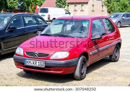 KOENIGSBRUECK, GERMANY - JULY 20, 2014: Motor car Citroen Saxo at the town street. - stock photo