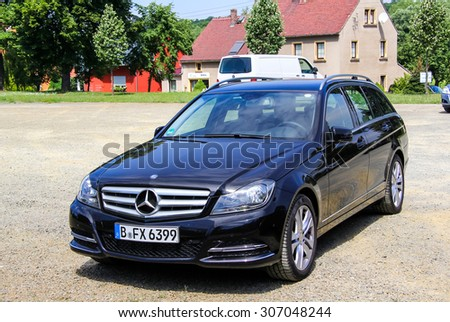 KOENIGSBRUECK, GERMANY - JULY 20, 2014: Motor car Mercedes-Benz W204 C180 at the town street. - stock photo