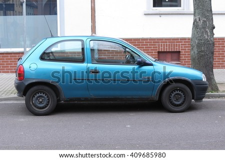 KOETHEN, GERMANY - CIRCA MARCH 2016: blue Opel Corsa Swing parked on the street - stock photo