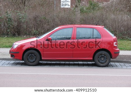 KOETHEN, GERMANY - CIRCA MARCH 2016: red Volkswagen Golf parked on the street - stock photo