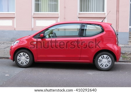 KOETHEN, GERMANY - CIRCA MARCH 2016: red Volkswagen Up parked on the street - stock photo