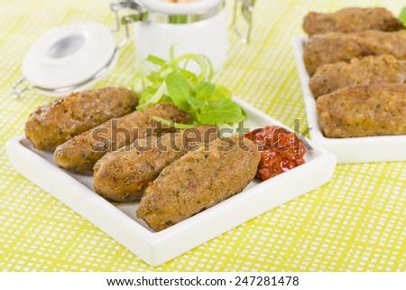 Koftas - Lamb koftas served with harissa. Middle Eastern meal! - stock photo