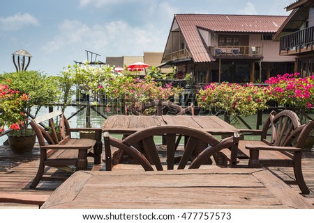 KOH CHANG, THAILAND - APRIL 3, 2015: Cafe on the veranda in the fishing village of Bang Bao tropical island of Koh Chang