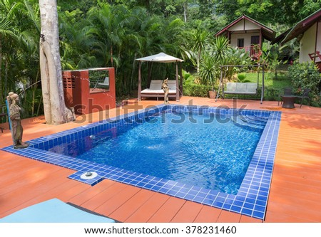 KOH CHANG, THAILAND - APRIL 2, 2015: Hotel Saint Tropez. Swimming pool in a tropical garden