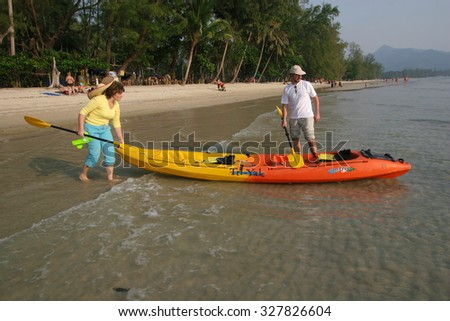 KOH CHANG, THAILAND - JANUARY 27, 2007: Tourists go on a kayaking trip.