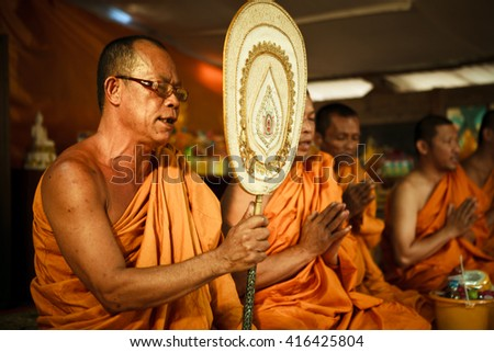 KOH CHANG, THAILAND - JUNE 11 2011: Thai monk during a traditional Buddhist blessing ceremony in a small local temple at Koh Chang island. - stock photo