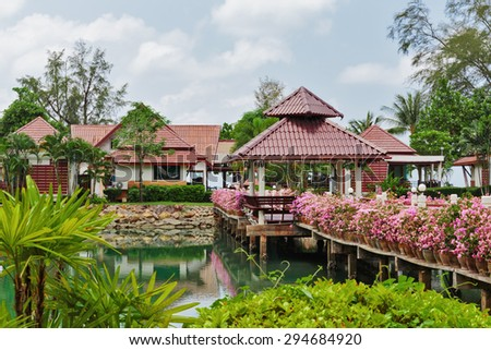 KOH CHANG, THAILAND - 31 MART, 2015: Klong Prao Resort. Bridge with flowers across the bay in a tropical garden