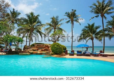 KOH CHANG, THAILAND - 31 MART, 2015: Klong Prao Resort. Swimming pool on a tropical beach - stock photo