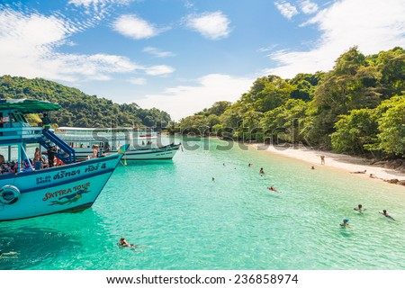 Koh Chang, Thailand - November 12 2014: Tourists enjoy the beach and swimming in a remote island )Koh Muk) near Koh Chang in Thailand