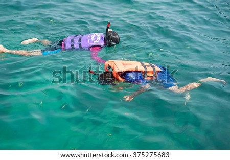 Koh kradan, Thailand March 19, 2015: Tourists enjoy the beach and the beautiful and wide and Koh kradan surrounded by the natural beauty of the islands in Trang province, Thailand