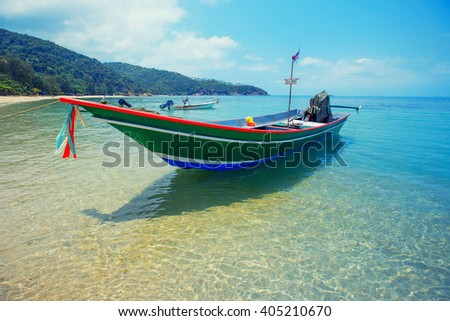 Koh Ma beach with boat at Koh Phangan Island, Thailand - stock photo