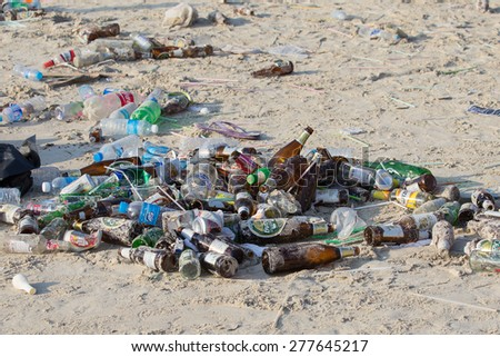 KOH PHANGAN,THAILAND - MAY 3, 2014 : Consequences of coast pollution on the Haad Rin beach after the full moon party