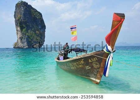KOH PODA - JAN 20: View of a longtail boat in a calm seas on Jan 20, 2014 on Koh Poda, Thailand. Koh Poda is a popular tourist Island in the Andaman sea of the coast of Thailand's Krabi province.