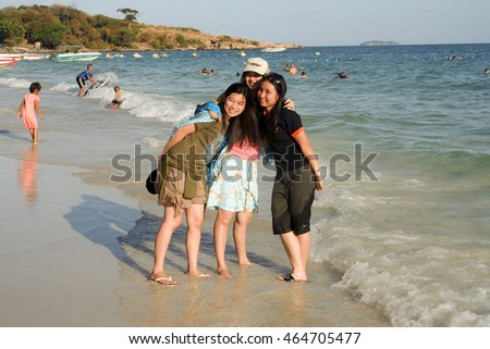 KOH SAMET, THAILAND - DECEMBER 12: japanese people pose for a picture at the beach on December 9, 2006 in Koh Samet, Thailand. Thailand is a major tourist spot for japanese people.