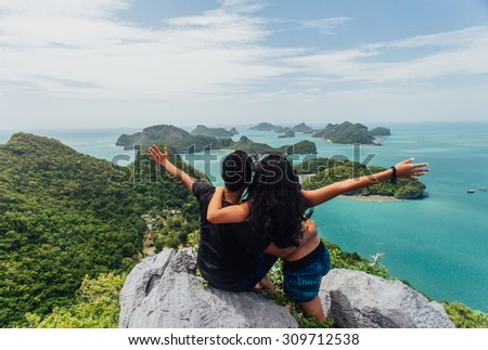 Koh Samui - July 4: A tourist couples were sitting at the view to the viewpoint AngThong National Park Photo taken July 04, 2015 in AngThong National Park, Koh Samui, Thailand